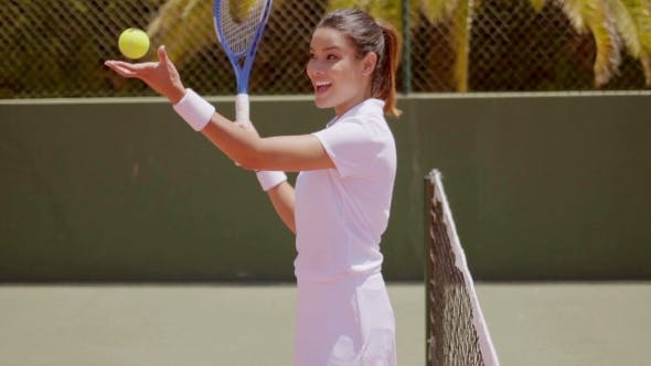 Thumbnail for Pretty Tennis Player Tosses Ball And Swings Racket