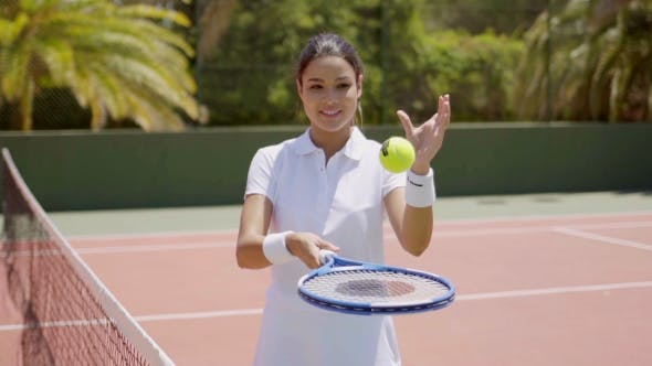 Cover Image for Pretty Female Tennis Player With Racket And Ball