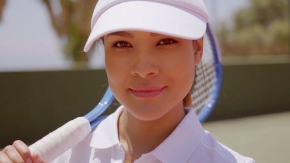 Thumbnail for Female Tennis Player With Racket Wearing Sun Visor