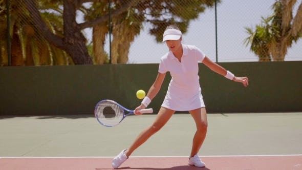 Thumbnail for Young Woman Playing a Game Of Tennis