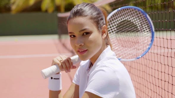 Thumbnail for Young Woman With Tennis Racket Sitting On Court