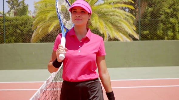 Thumbnail for Attractive Athlete Poses Near Net In Tennis Court