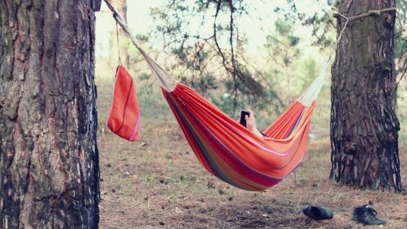 Thumbnail for Hammock Relax. Young Woman Using Smart Phone In Hammock At Forest