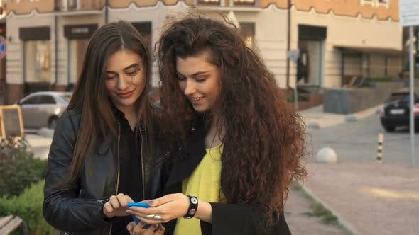 Thumbnail for Female Friends Watch Photos on Smartphone