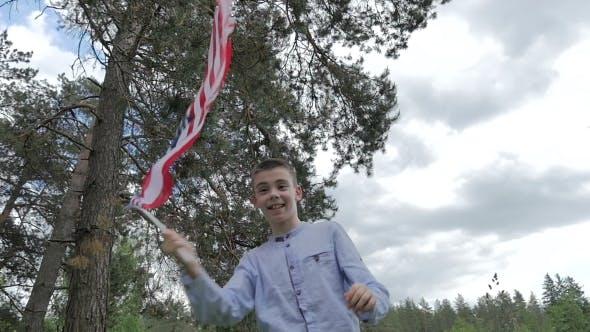 Thumbnail for Young Boy Waving USA Flag