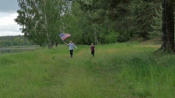 Thumbnail for Children Running With The U S Flag