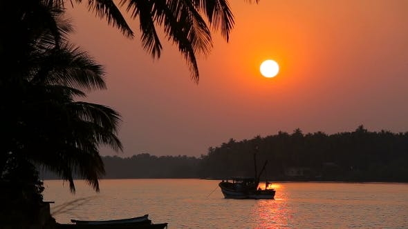 Thumbnail for Tropical Sunset Seascape With a Boat
