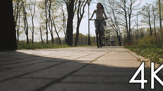 Cover Image for The Girl Riding a Bicycle Along The Road