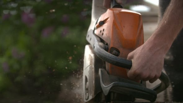 Thumbnail for Cutting Through Wood With Chainsaw In