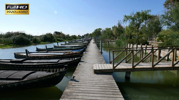 Thumbnail for Walking Down the Wooden Jetty in the Canal