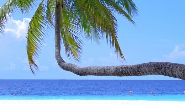 Tropical Island at Maldivian Atoll in Indian Ocean