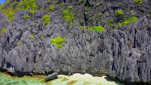 Jagged Limestone Cliffs of Matinloc Island at Palawan, Philippines