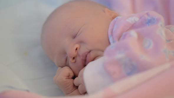 Newborn Baby Girl Moving Being Asleep