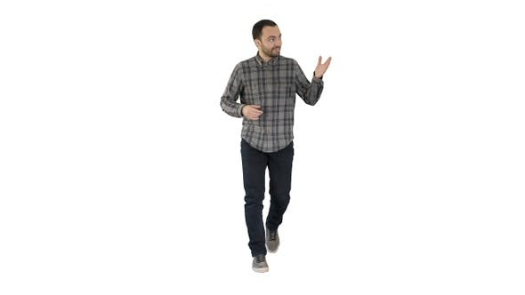 Thumbnail for Young confident man in shirt and jeans walking towards