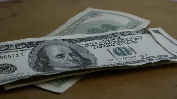 Rotating stock footage shot of $100 bills - MONEY 0156