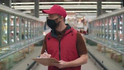 Merchandiser Working In Hypermarket