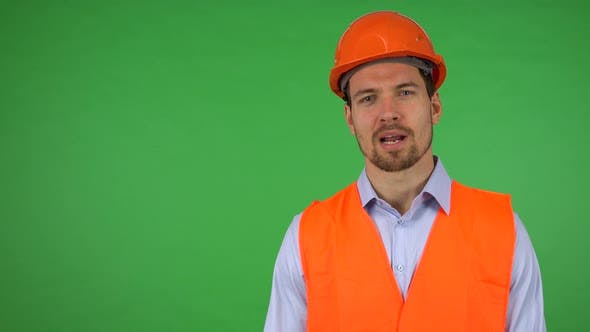 Thumbnail for A Young Handsome Construction Worker Talks To the Camera with a Smile - Green Screen Studio