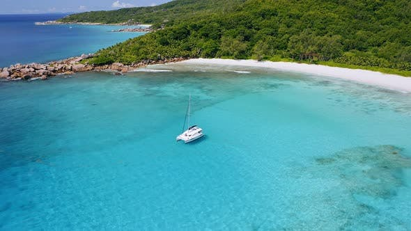 Thumbnail for Aerial View of Luxury Catamaran Yacht Moored in Crystal Clear Blue Lagoon. Amazing Tropical Sandy