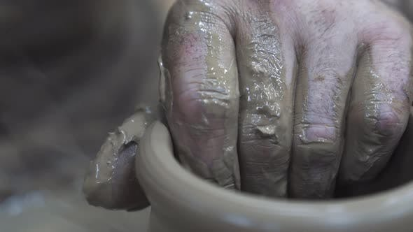 Thumbnail for The sculptor male hands