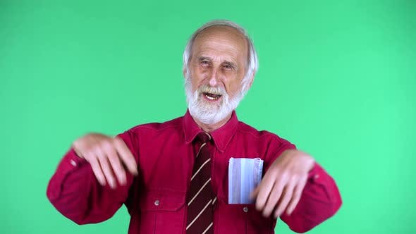 Cover Image for Portrait of Happy Old Aged Man 70s Clapping His Hands, Isolated Over Green Background.