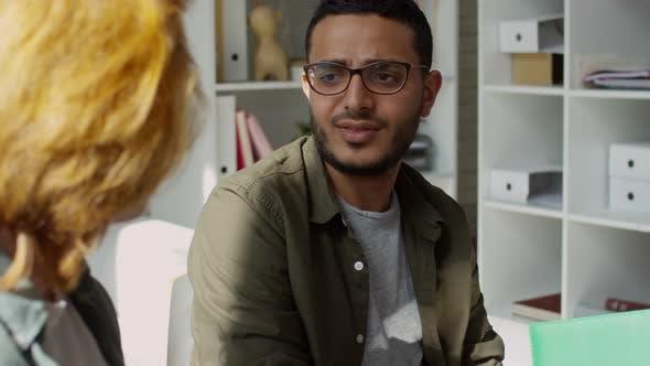 Thumbnail for Hesitant Arabic Man Talking to Colleague