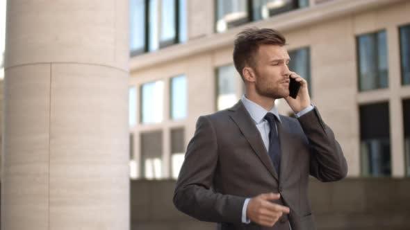 Thumbnail for Caucasian Businessman Having Phone Conversation Outdoors