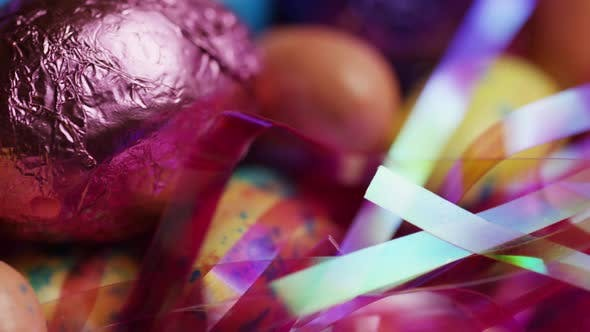 Thumbnail for Rotating shot of colorful Easter candies on a bed of easter grass - EASTER