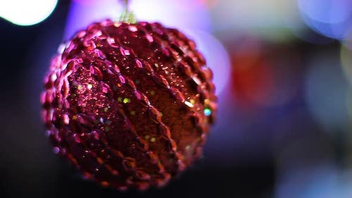 Beautifully Decorated with Sequins Big Red Ball Slowly Swinging Hypnotizing