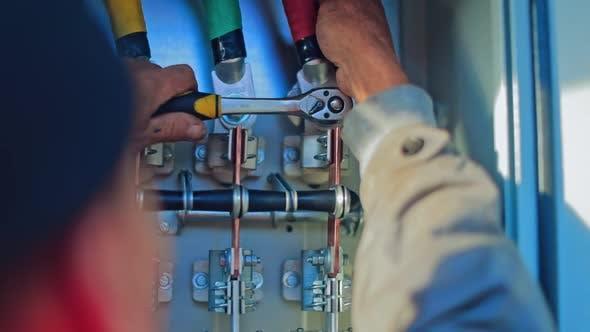 Engineer repairing electricity box. Maintenance worker adjusting solar panels