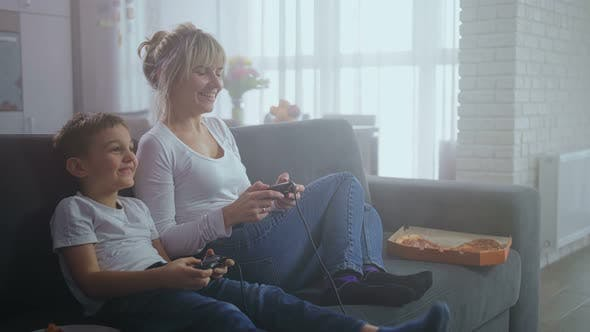 Cover Image for Joyful Mother and Son Playing Video Game at Home