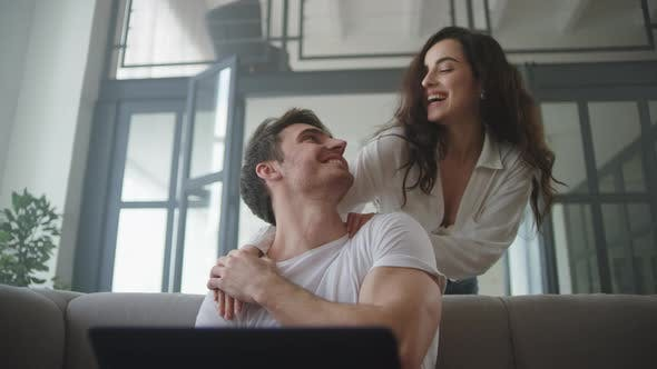 Thumbnail for Business Man Working Laptop Computer at Home. Happy Couple Hugging at Home