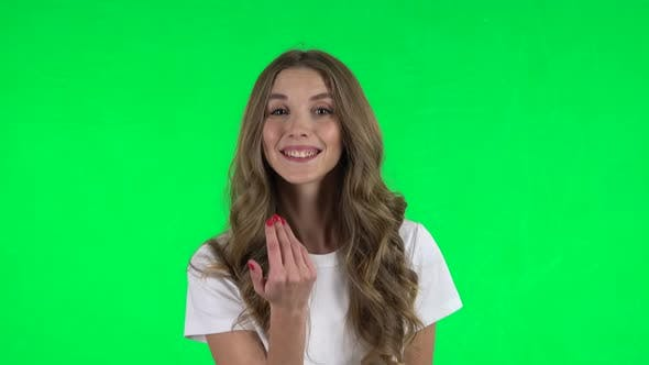 Thumbnail for Lovable Girl Waving Hand and Showing Gesture Come Here. Green Screen