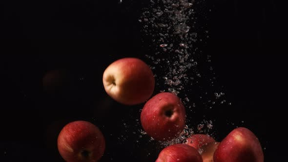 Thumbnail for Red Apples Pouring To Water on Black Background, Fruits Falling Into Water, Slow Motion