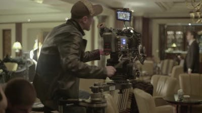 Cameraman with a Camera During Filming. Filmmaking. Shooting.