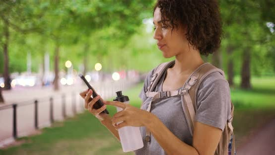 Thumbnail for Gorgeous African female takes selfie at beautiful park