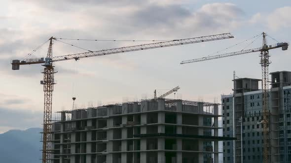 Thumbnail for Tower Crane on a Construction Site Lifts a Load at High-rise Building. Timelapse. Building