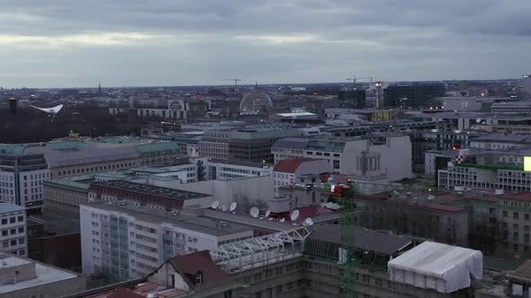Thumbnail for AERIAL: Slowly Flying Over Center of Berlin Germany with Construction Site Cranes at Sunset