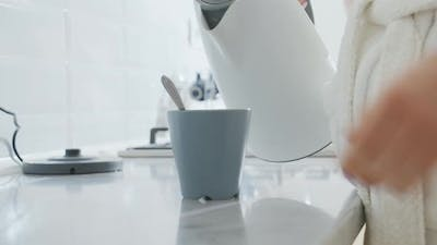 Close Up of Woman Making Coffee on Kitchen