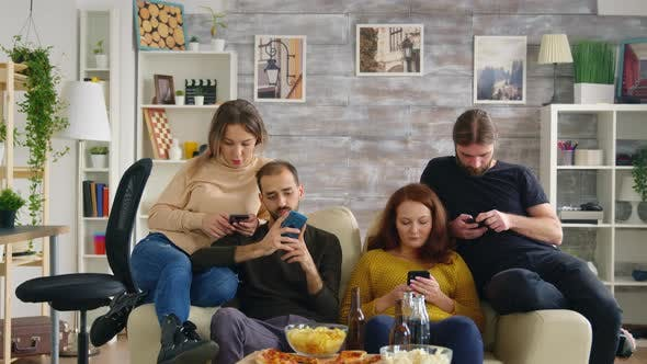 Thumbnail for Group of Friends Sitting on Couch in Living Room