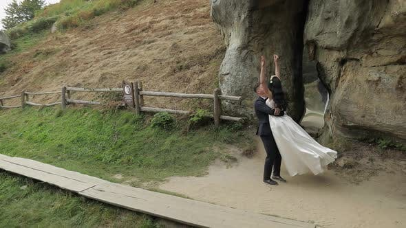 Thumbnail for Groom with Bride Dancing Near Mountain Hills. Wedding Couple in Love