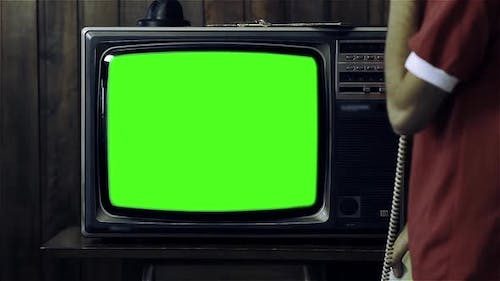 80s TV with Green Screen and a Young Man Talking On 80s Phone.