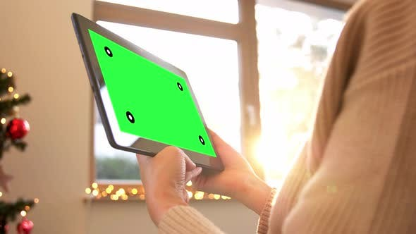Thumbnail for Woman with Green Screen on Tablet Pc on Christmas