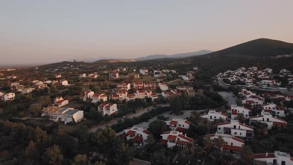 Thumbnail for Cottages and Hills Scene of Trikorfo Beach in Greece, Aerial