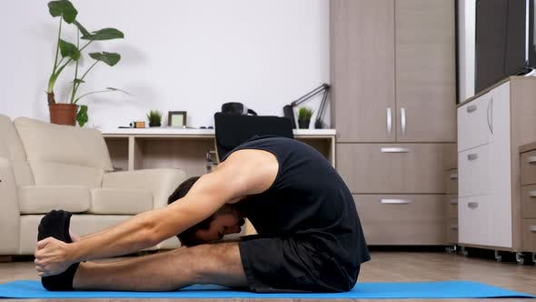 Thumbnail for Man Stretches and Does Different Yoga Poses