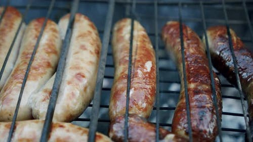 Sausages Are Fried on an Open Fire, Close Up Slow Motion V2