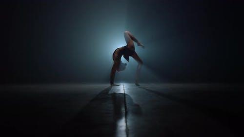 Flexible Gymnast Doing Backbend Exercises