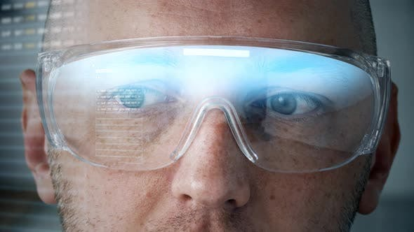 Thumbnail for Close Up of Man in Smart Glasses with Coding 84