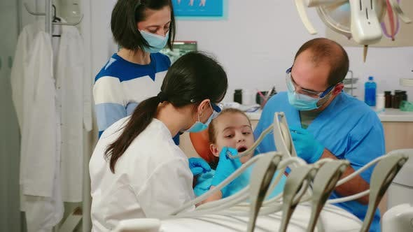 Thumbnail for Child Sitting in Stomatological Chair Opening Mouth