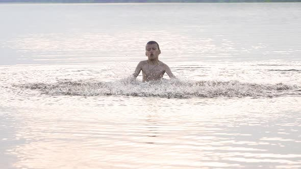 Thumbnail for Boy is Bathed in the River and Splashing Water