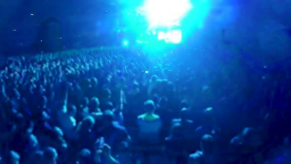 Thumbnail for Crowd of People Standing and Jumping in Front of Big Stage at Stadium, Concert